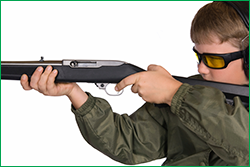 Boy Shooting a Rifle